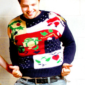 young man in his 20s wearing an ugly christmas sweater
